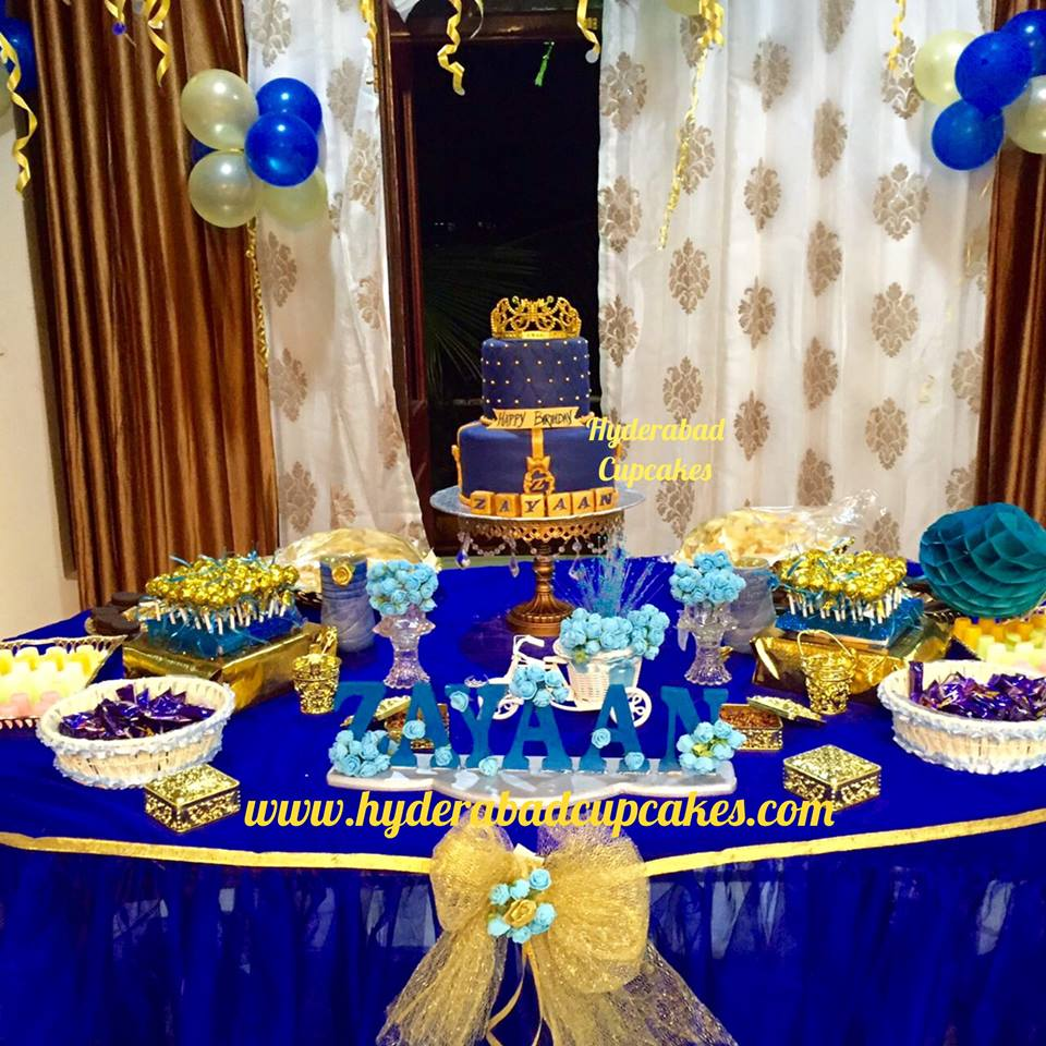 A grand Royal Prince themed dessert table fit for royalty! Vanilla cake with all edible handmade decoration & a keepsake gold crown!